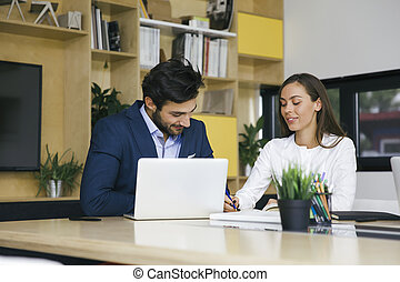 Young business team working on computer in office