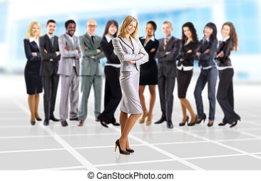 Young business woman and her team isolated over office background