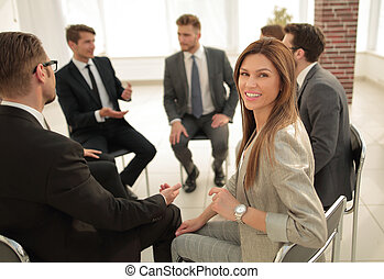 young business woman at a business meeting with the business team