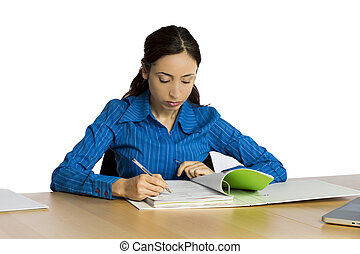 Young business woman checking her work