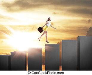 Young business woman climbs up on cubes staircase.