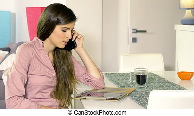 Young business woman getting angry on the phone while working at home