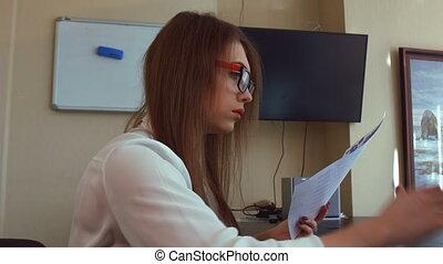 Young business woman has a headache from working at the computer.