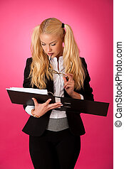 Young business woman holding a folder in her hands