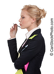 Young business woman in a black suit holding pen