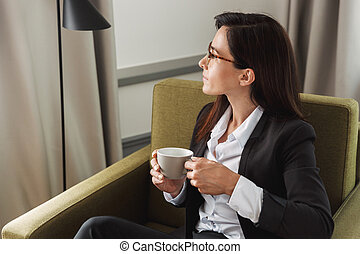 Young business woman in formal wear clothes indoors at home...