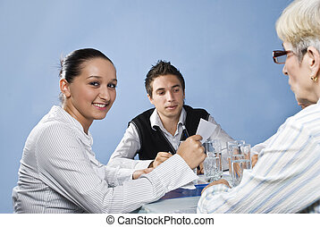 Young business woman in middle of meeting