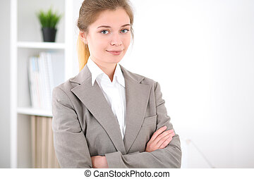 Young business woman in office. Successful business concept.