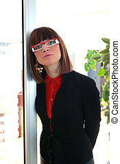 young business woman in red at office