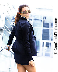 Young business woman in the big city purposefully looking away.
