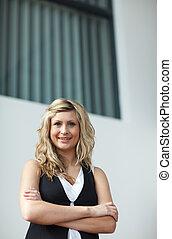 Business woman looking at camera
