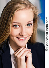 Young business woman on close-up portrait
