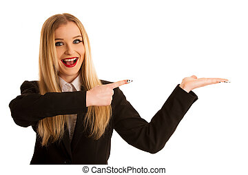 young business woman pointing in copy space as advertisement for a product