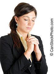 Young business woman praying