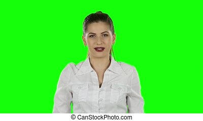 Young business woman presenting something by a hand. Green screen