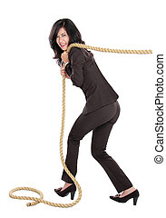 Young business woman pulling a rope