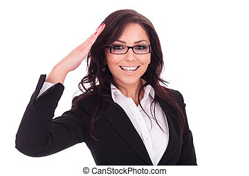 business woman saluting - young business woman saluting you...
