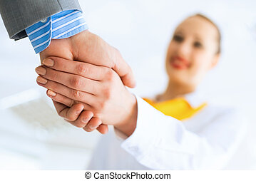 business woman shaking hands with a client
