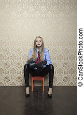 young business woman sitting on a stool