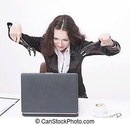 young business woman smashing a laptop. isolated on white.