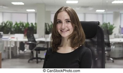 Young business woman smiling at workplace in office