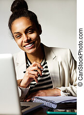 Young business woman smiling with laptop