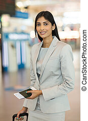 young business woman standing in airport