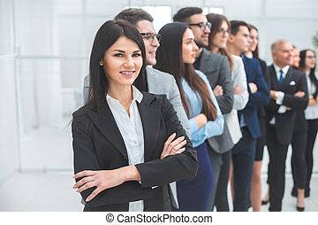 young business woman standing in front of her colleagues