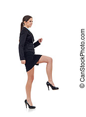 Young business woman stepping on imaginary step