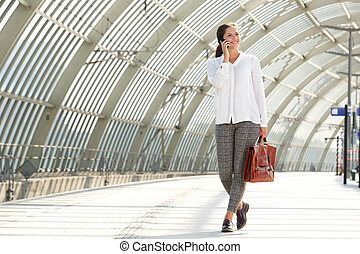 young business woman talking on mobile phone
