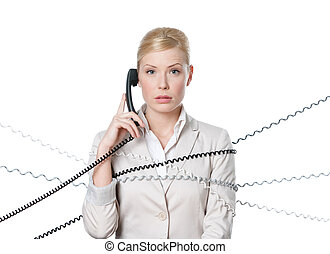 Young business woman tied with phone cord