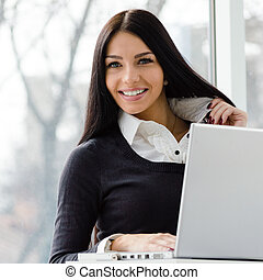 young business woman using laptop PC at office - Portrait of...