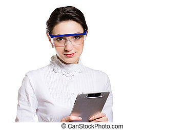 Young business woman using tablet PC and wearing glasses in...