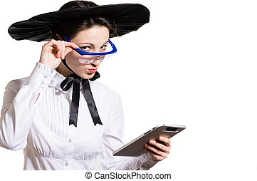 Young business woman using tablet PC and wearing glasses and...