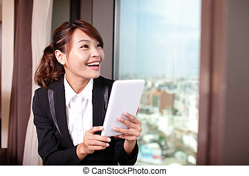 Young business woman using tablet pc