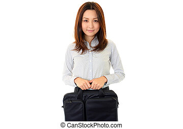 Young business woman with a bag