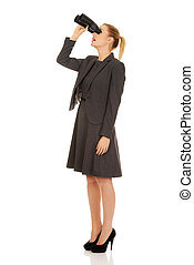 Young business woman with a binocular