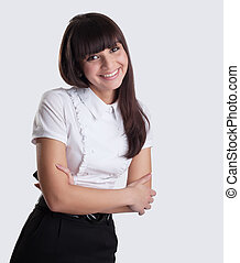 Young Business woman with cell in hands smile to you