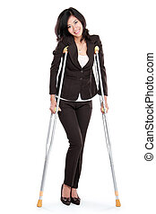 business woman with crutches - Young business woman with...