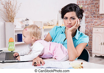 business woman with laptop and her baby girl