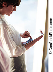 business woman working on tablet computer