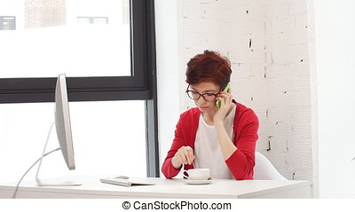 Young business woman working online shopping at her office.