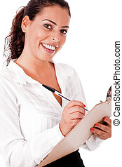 Young business woman writing in a clip Board