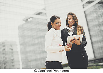 Young business women in front of office building