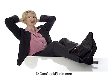 relax - young business women sitting and relaxing on white