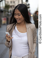 Young business women with cell phone
