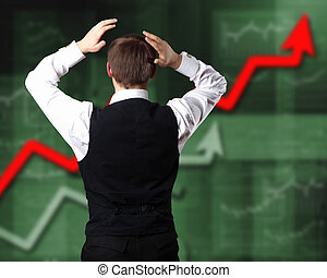 Young businessman against financial graphs - Young...