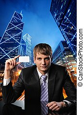 Young businessman against urban city view