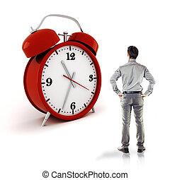 young businessman and an alarm clock