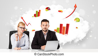 Young businessman and businesswoman with cloud in the background containing colorful graphs and diagrams